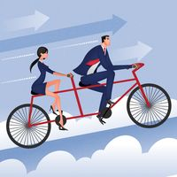 Businessman and businesswoman cycling