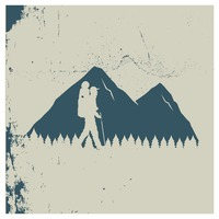 Double exposure of mountains and mountaineer