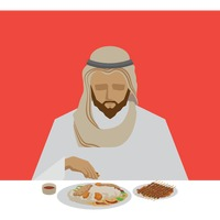 Man eating kabsa dish