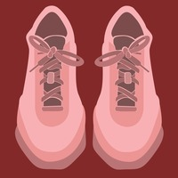 Pink sports shoes on red background