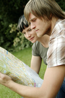 A couple analyzing a map in the park