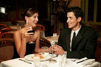 A couple in dinners wear celebrating their anniversary in the restaurant