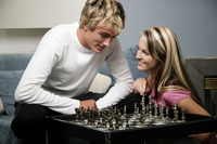 A couple playing chess together
