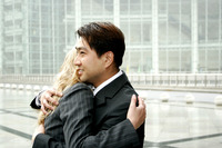 A man and a woman in business suits hugging