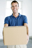 A man passing over a parcel happily