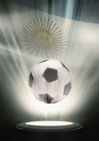 A soccer ball with argentina flag backdrop