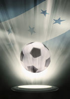 A soccer ball with honduras flag backdrop
