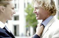 A woman adjusting tie for her boyfriend