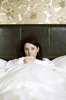 An ill woman in bed
