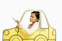Annoyed woman looking out of a cardboard car window