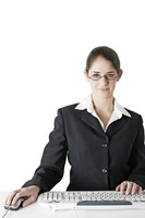 Bespectacled businesswoman using computer