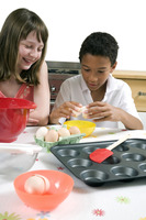 Boy and girl learning baking
