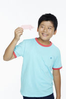 Boy playing with a miniature paper pig