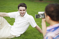 Boy recording images of man