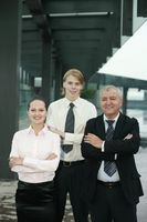 Business people with their arms folded