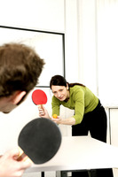 Businessman and businesswoman playing table tennis