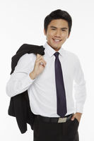 Businessman carrying a jacket over his shoulder