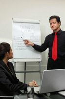 Businessman explaining his plan on a board to a partner at the meeting