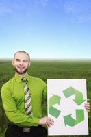 Businessman holding a recycle sign