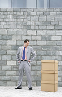Businessman looking at a stack of boxes