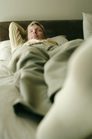 Businessman lying on the bed sleeping