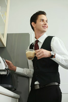Businessman making coffee in office pantry