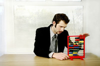 Businessman playing with children abacus