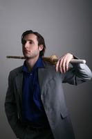 Businessman posing with a sword