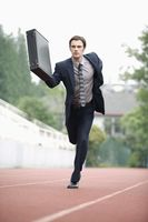 Businessman running on track