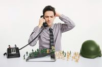 Businessman scratching his head while answering phone calls