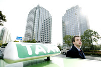 Businessman standing beside a taxi