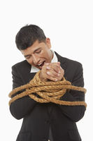 Businessman tied up and held hostage