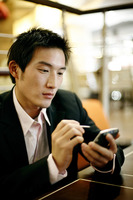 Businessman using palmtop