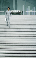 Businessman walking down the stairs