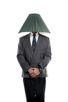 Businessman with a lamp shade covering his head