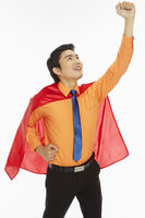 Businessman with a red cape showing hand gesture