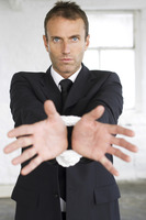 Businessman with his wrist tied up