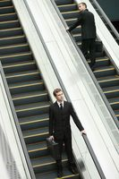 Businessmen on escalator