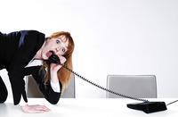 Businesswoman answering call in an uncomfortable way