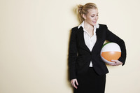 Businesswoman holding a ball