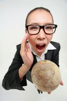 Businesswoman holding a globe and shouting