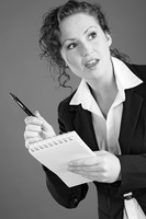 Businesswoman holding a pen and a notepad