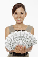Businesswoman holding a pile of cash