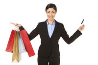 Businesswoman holding shopping bags and a credit card
