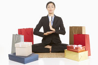 Businesswoman meditating with eyes closed