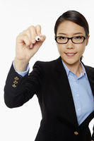 Businesswoman showing writing gesture