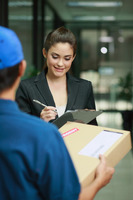 Businesswoman signing for package