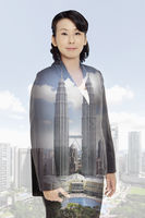 Businesswoman standing against a cityscape background