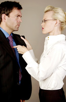 Businesswoman threatening businessman