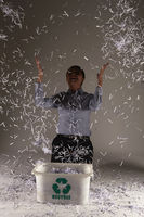 Businesswoman throwing shredded paper in the air